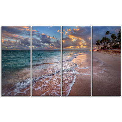 Designart Palm Trees On Clear Sandy Beach SeashoreCanvas Art Print - 4 Panels