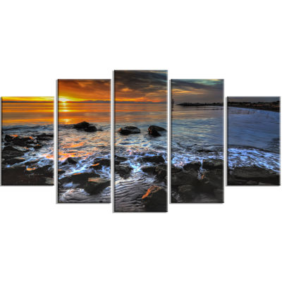 Designart Sunset Over Rocky Ocean Shore (373) Landscape Canvas Art Print - 5 Panels