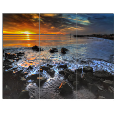 Designart Sunset Over Rocky Ocean Shore LandscapeCanvas Art Print - 3 Panels