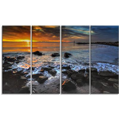 Designart Sunset Over Rocky Ocean Shore LandscapeCanvas Art Print - 4 Panels