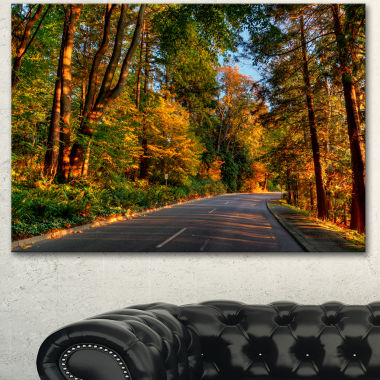 Designart Road Through Lit Up Fall Forest Landscape Canvas Art