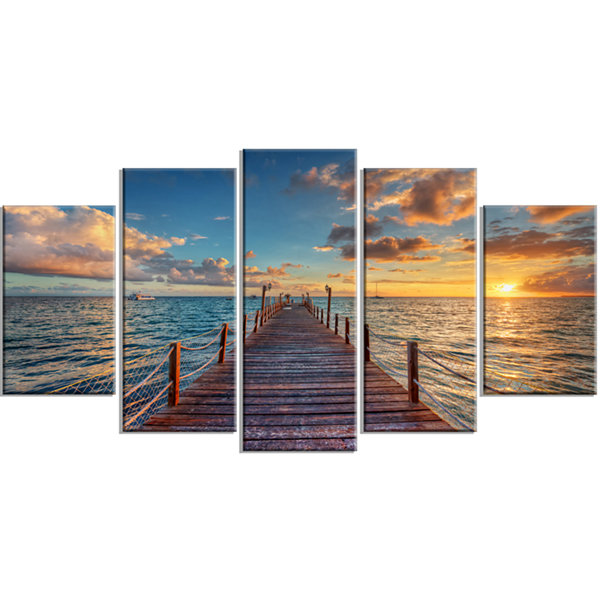 Designart Brilliant Sunrise Over Sea Pier (373) Modern Canvas Art Print - 5 Panels