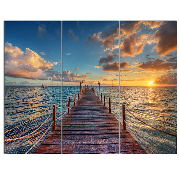 Designart Brilliant Sunrise Over Sea Pier ModernCanvas Art Print - 3 Panels