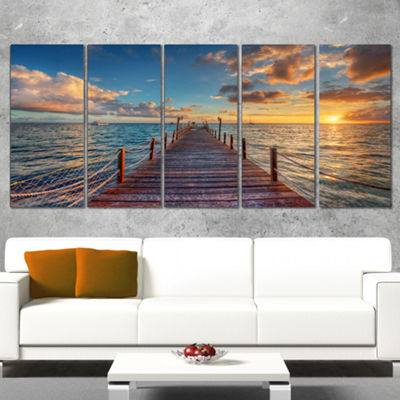 Designart Brilliant Sunrise Over Sea Pier ModernCanvas Art Print - 5 Panels