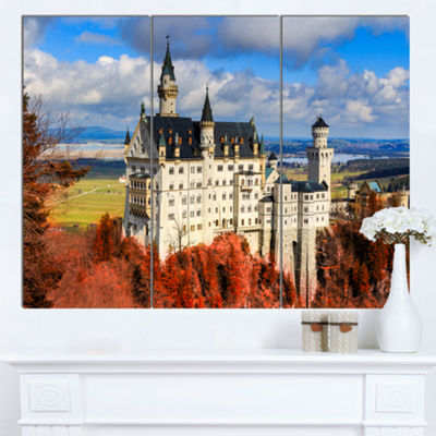 Designart Neuschwanstein Castle With Red FoliageLandscape Canvas Art - 3 Panels