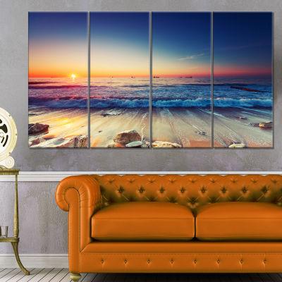 Designart Beautiful Sunrise Over Blue Sea CanvasArt Print - 4 Panels