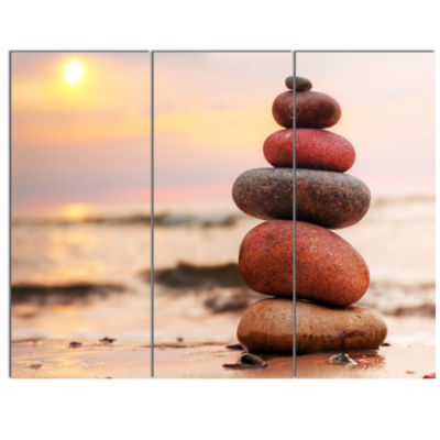 Designart Stones Pyramid On Sand Symbolizing ZenLandscape Canvas Art Print - 3 Panels