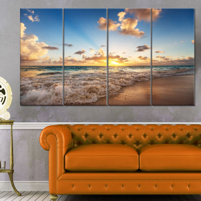 Designart Sunrise On Beach Of Caribbean Sea CanvasArt Print - 4 Panels