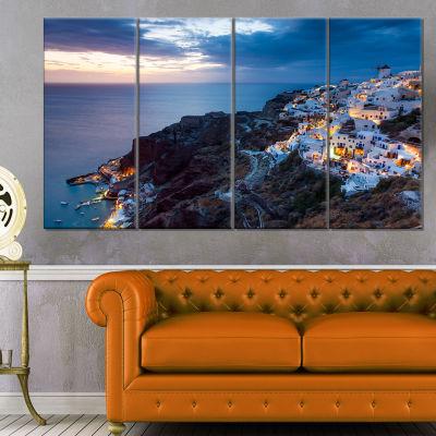 Designart Night Shot Oia Santorini Greece SeashoreCanvas Art Print - 4 Panels