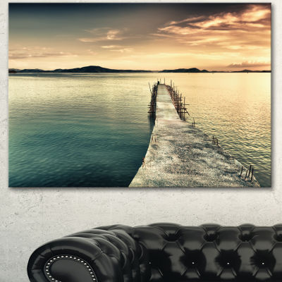 Designart Sea Bridge Into The Deep Ocean Bridge Canvas Art Print