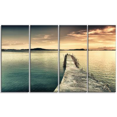 Designart Sea Bridge Into The Deep Ocean Bridge Canvas Art Print - 4 Panels