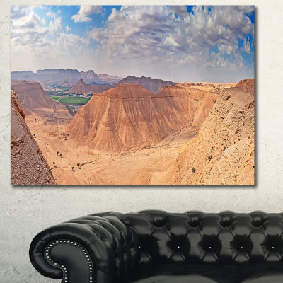 Designart Clay Rocks Around Riyadh City LandscapeCanvas Art Print
