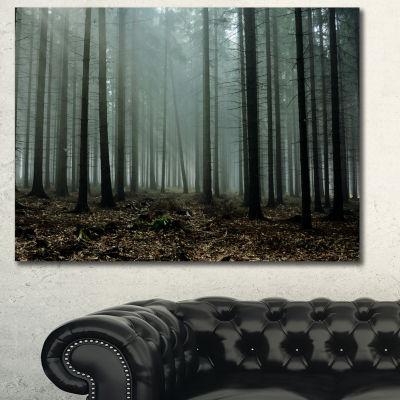 Designart Gloomy Sunrays In Dark Forest LandscapeCanvas Art Print - 3 Panels