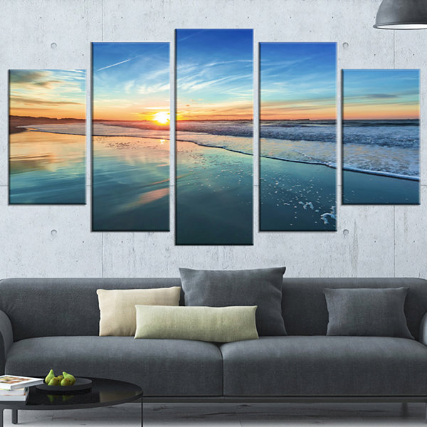Designart Blue Seashore With Distant Sunset CanvasArt Print - 5 Panels