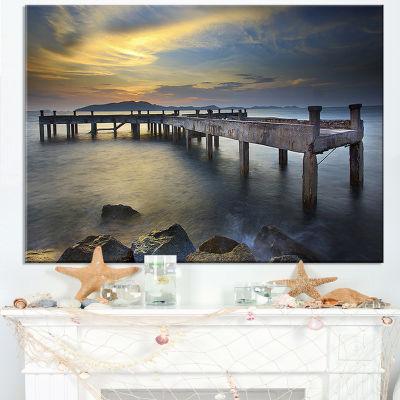 Designart Old Wood Boat Jetty Into Blue Sea BridgeCanvas Art Print