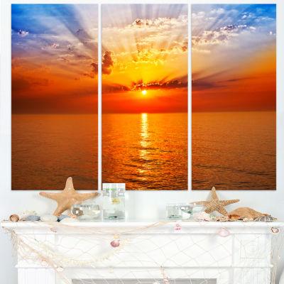 Designart Orange Sea Sunrise Under Blue Sky Seashore Canvas Print - 3 Panels