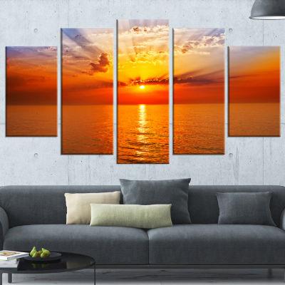 Designart Orange Sea Sunrise Under Blue Sky Seashore Canvas Print - 5 Panels