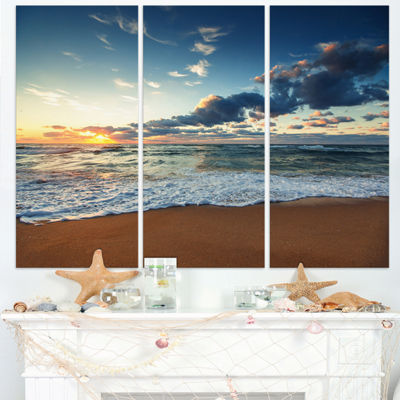 Designart Sunrise And Glowing Waves In Ocean Seascape Canvas Art Print - 3 Panels