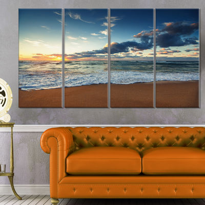 Designart Sunrise And Glowing Waves In Ocean Seascape Canvas Art Print - 4 Panels