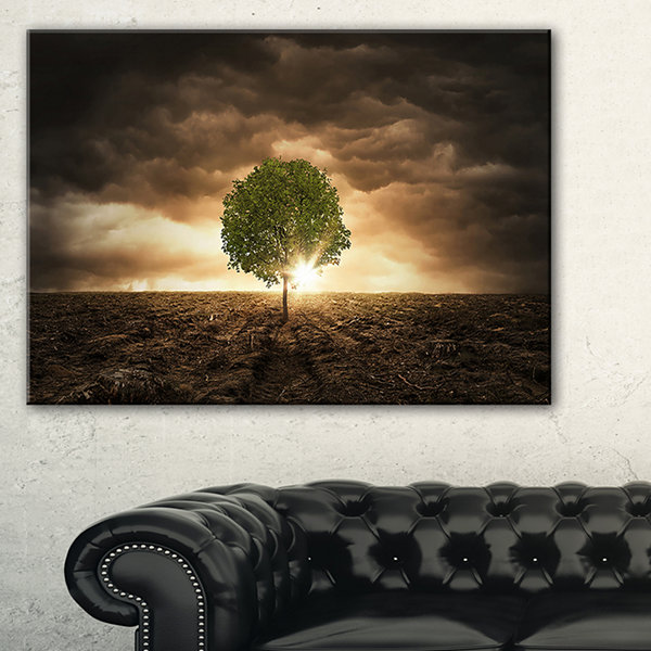 Designart Lonely Tree Under Dramatic Sky Wall ArtLandscape