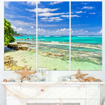 Designart Tranquil Seychelles Tropical Beach Modern Seascape Canvas Artwork - 3 Panels