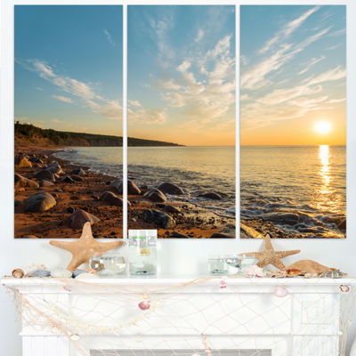 Design Art Ocean Shore At Sunrise With Rocks Modern Canvas Artwork - 3 Panels