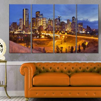 Designart Skyline Of Calgary At Night Panorama Modern Cityscape Canvas Wall Art - 4 Panels