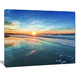 Designart Blue Seashore With Distant Sunset CanvasArt Print