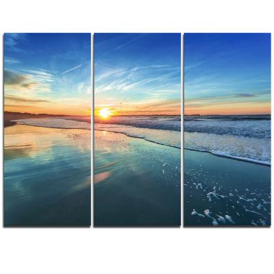 Design Art Blue Seashore With Distant Sunset Canvas Art Print - 3 Panels