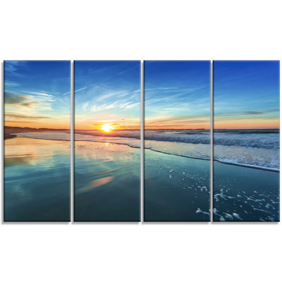 Design Art Blue Seashore With Distant Sunset Canvas Art Print - 4 Panels