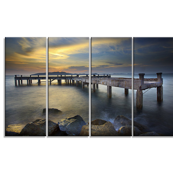 Design Art Old Wood Boat Jetty Into Blue Sea Bridge Canvas Art Print - 4 Panels