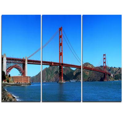 Designart Golden Gate Bridge Under Blue Sky Cityscape Canvas Print - 3 Panels