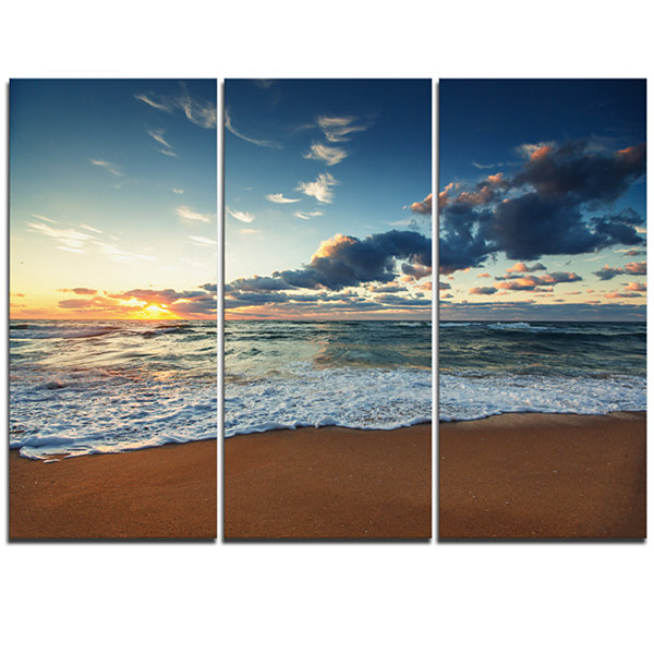 Design Art Sunrise And Glowing Waves In Ocean Seascape Canvas Art Print - 3 Panels