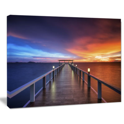 Designart Picturesque Seashore With Long Pier Canvas Art Print