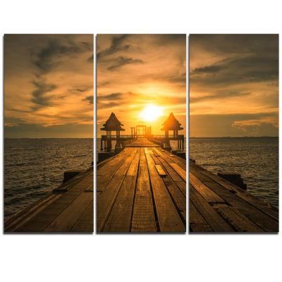 Designart Huge Wooden Bridge To Illuminated Sky Pier Seascape Canvas Art Print - 3 Panels