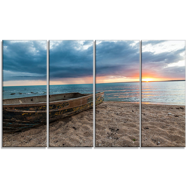 Designart Rusty Row Boat On Sand At Sunset Seascape Art Canvas - 4 Panels