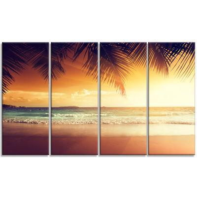 Design Art Palm Leaves On Caribbean Seashore Modern Seashore Canvas Art - 4 Panels