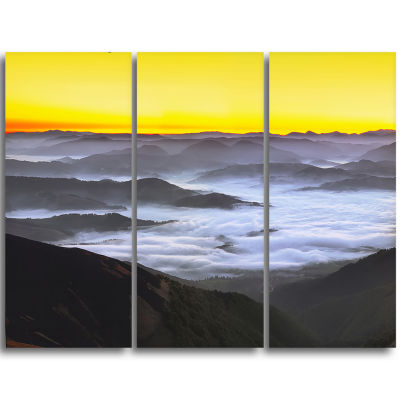 Designart Yellow Sky And Foggy Mountains LandscapeCanvas Art Print - 3 Panels