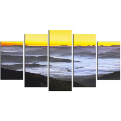 Designart Yellow Sky And Foggy Mountains LandscapeCanvas Art Print - 5 Panels