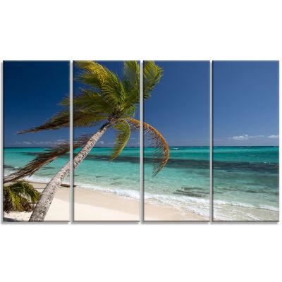 Designart Palm Bent To Picturesque Seashore ModernCanvas Artwork - 4 Panels
