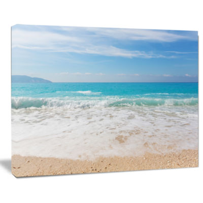 Designart White Waves Kissing Beach Sand SeashoreCanvas Print