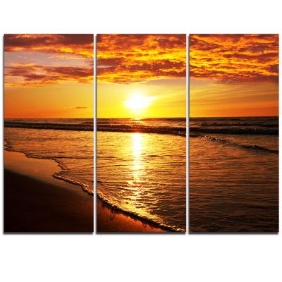 Designart Bright Yellow Sunset Over Waves Modern Beach Canvas Art Print - 3 Panels