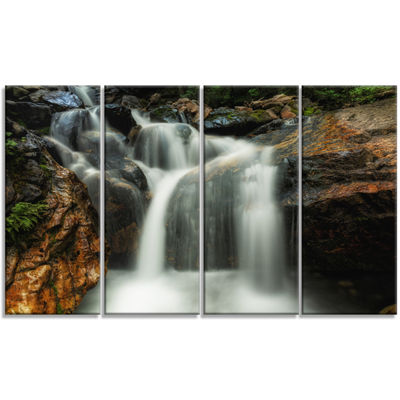 Designart Slow Motion Waterfall On Rocks LandscapeCanvas Art Print - 4 Panels
