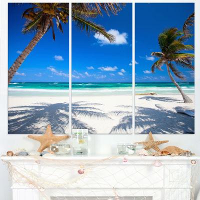 Designart Coconut Palms At Beach Photo LandscapeCanvas Art Print - 3 Panels