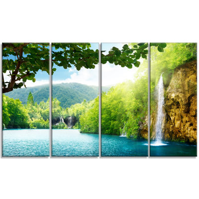 Designart Waterfall In Deep Forest Landscape Photography Canvas Art Print - 4 Panels