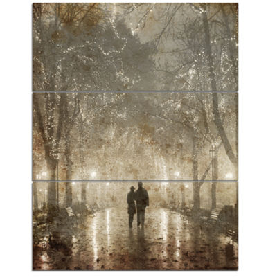 Designart Couple Walking In Night Lights LandscapePhotography Canvas Print - 3 Panels