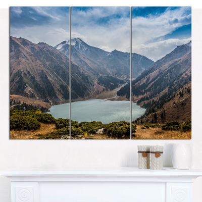Designart Mountain Lake Under Blue Sky LandscapeCanvas Wall Art - 3 Panels