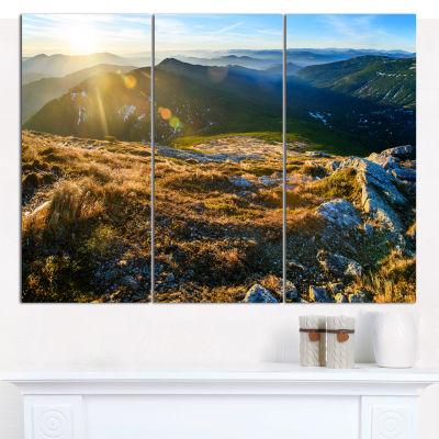 Designart Mountains Glowing In Sunlight LandscapeCanvas Wall Art - 3 Panels
