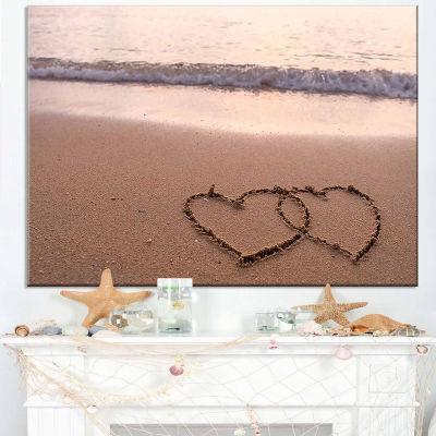 Designart Two Hearts Drawn On The Beach Seascape Art Canvas