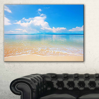 Designart Clouds Over Calm Beach Seashore Photo Canvas Print